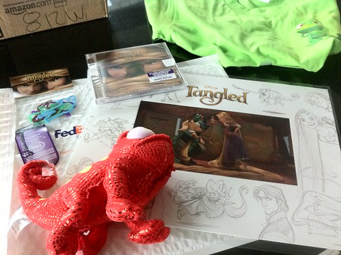 My Tangled items from Klout. Thinking I'll give them to @Bill80's daughter