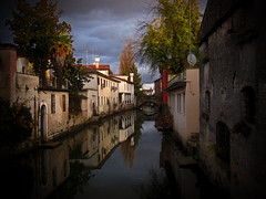 Sul fiume (Immacolata Giordano) Tags: november autumn rain clouds photoshop reflections river nuvole novembre fiume vignetting autunno riflessi pioggia veneto portogruaro vignettatura lemene compatta canondigitalixus100is