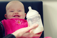 you make me happy (ronny..) Tags: pink girl smile smiling laughing happy bottle funny feeding giggle squint d90 nikon50mm14g ourdailychallenge droptheshutter