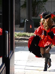 Urban pirate (Pacific Lime (Catching Up!)) Tags: street city red people urban woman color reflection hat town costume crossing dress boots candid down pirate