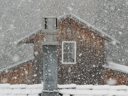 Snow Falling on Barn