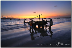back home - jimbaran bali (fiftymm99) Tags: sunset sea people bali water boat seaside fishing fisherman sand nikon wave jimbaran d300 fiftymm fiftymm99