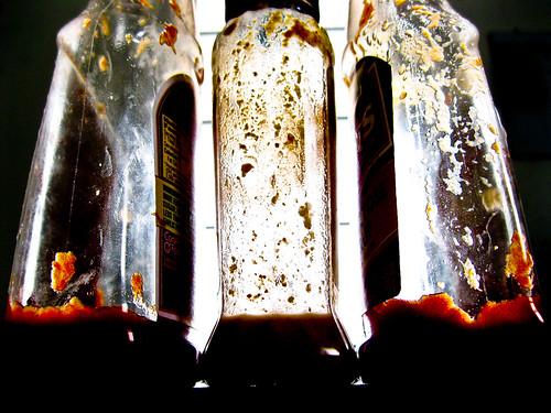nearly empty sauce bottles