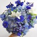 Nigella, cornflower, white freesia, hydrandea, delphinium
