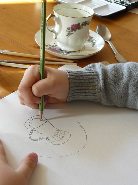 drawing his cup