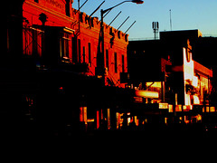 Sunset reflecting street in sydney (Dawn Woodhouse) Tags: sunset red shells flower colour rot cakes cake rock rouge rojo sydney australia rood rosso ahmar eastershow kokino crven
