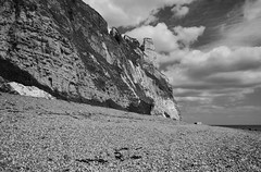 Underhooks cliffs (Alastair Cummins) Tags: sea bw cliff beach weed nikon stones pebbles cliffs devon 1855mm jurassic branscombe d40 underhook