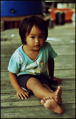 Innocent Life (Manic~Mind) Tags: street portrait people girl children 50mm kid nikon toddler village unique candid young human portraiture malaysia borneo stare kotakinabalu moment nikkor f18 malaysian gaze sabah spontaneous humaninterest timing d90 sabahan pulaugaya humanstudies gayaisland manicmind