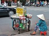 vendeuse dans les rues de Saigon (pontfire) Tags: voyage street city trip travel vacation portrait people urban woman holiday plant man flower men fleur animal fruit plante river children temple town asia vietnamese femme vietnam asie enfant saigon mekong ville homme cantho hochiminh