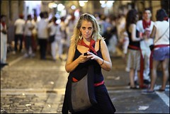 Pamplona, Spain. The party the night before the running of the bulls. Photo #14 (ArchedRoof) Tags: world street red party woman white black sexy cup girl female night trash canon dark square town amazing spain lowlight alone time crowd clubbing running streetscene scene eerie bull bulls spooky litter nighttime rubbish stare lonely drunkards pamplona texting hardcorestreetphotography revellers drunkpeople goers spanishpeople pissedpeople 5dm2