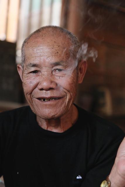 Smoking man in Chengyang, Guangxi, China