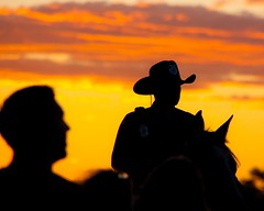 Mounted Policeman At Sunset (Marvin Bredel) Tags: sunset horse newmexico silhouette albuquerque mounted crowdcontrol policeman albuquerqueinternationalballoonfiesta westernhat marvin908 marvinbredel
