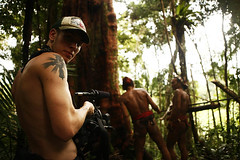 Cale filming (joeyL.com) Tags: lighting tattoo ferry trekking indonesia boat rainforest photoshoot battery uma culture photographers tourists generator western hunter guide explorers healing behindthescenes ricky travelers translator shamanism solarpower sacrafice gatherer joeylawrence profoto elinchrom joeyl mentawai siberut caleglendening gejeng willemisbrucker