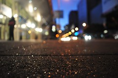 The stars aren't the only thing that shine at night. (eddylazophotography) Tags: street city urban sparkles nikon shiny bokeh pavement shining nikond5000
