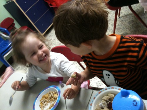 Random photo of Walker and Madeline loving each other over cereal