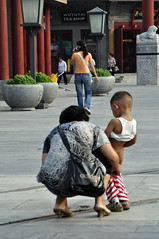 Comfort stop (Roving I) Tags: china streets boys beijing relief motherhood infants peeing