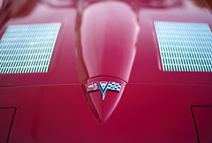 Vette hood closeup w (hirevimaging) Tags: auto leica cruise red classic cars car newjersey bokeh dusk muscle awesome nj fast cruising rangefinder american somerville classics jersey noctilux corvette vette cruises bokehlicious leicam8 dellapiazza dandellapiazza leicanoctilux50mmf10