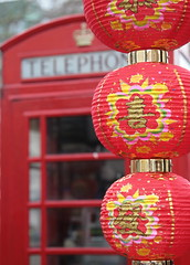 East Meets West (Deydodoe) Tags: city uk greatbritain red england urban west london festival canon flickr all phone unitedkingdom britain © chinese chinesenewyear east celebration rights leicestersquare british lantern oriental reserved westend telephonebox phonebox 2007 30d publictelephone canon30d canonef24105mmf4lisusm ©allrightsreserved deydodoe