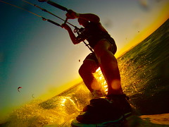Sunset Kitesurf (guerilladogs) Tags: africa sunset sea sun kite water lines silhouette sport speed fun golden wake arms angle legs go joy wide egypt fast wave el lagoon kiteboarding kitesurfing spray gouna flare pro shorts splash