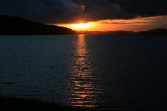 Sunset Ardvreck (Little Boffin (PeterEdin)) Tags: light red sky orange sun sunlight slr clouds canon fire eos rebel scotland solar alba sunsets loch dslr sutherland canoneos singlelensreflex ecosse ardvreck lochassynt northwestscotland highlandcouncil 400d rebelxti canoneos400d canonrebelxti canon400d digitalsinglelensreflex thehighlandcouncil thankyouforflickr
