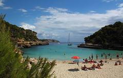 Cala Llombards (Lau Snow) Tags: sea summer sky people holiday green beach pine clouds canon de island spain sand mediterraneo mallorca palma vacaciones cala islasbaleares