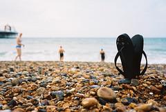 flip flops (lomokev) Tags: sea beach sport swimming swim pier nikon brighton dof kodak stones kodakportra400vc depthoffield swimmers portra nikonos kodakportra400 kodakportra deletetag nikonosv nikonos5 nikonosfive roll:name=100924nikonosvvc file:name=100924nikonosvvc13