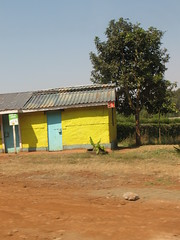 Yellow Shop (aaron.knox) Tags: africa road roof building tree sign yellow shop highway kenya fromacar kikuyu a104 centralprovince safaricom tireplanter nairobiroad topuphere