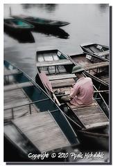 Boatman (mpalis) Tags: wood man men water vertical river boats boat wooden still fisherman sitting adult objects nobody row transportation tranquilscene rowingboat nauticalvessel
