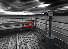 Sit here....look there... (i.m.j.) Tags: blue red wales clouds sunrise dawn coast pier cymru wideangle telescope peelingpaint beaumaris selectivecolour anglesey arfordir efs1022mm13545usm canon7d