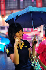 Colors of the rain (yeryi) Tags: china street portrait color colors girl rain mobile night umbrella walking asian thailand 50mm lights luces noche calle lluvia movement nikon asia chinatown dof phone nightshot bokeh walk retrato bangkok telephone movil tailandia mobil move colores tai rainy thai 18 calling siam telefono paraguas brolly d90 rainynightsinbangkok colorsoftherain