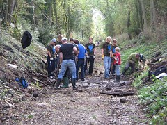 Student volunteers working alongside our project volunteers to repair the trackbed drainage system
