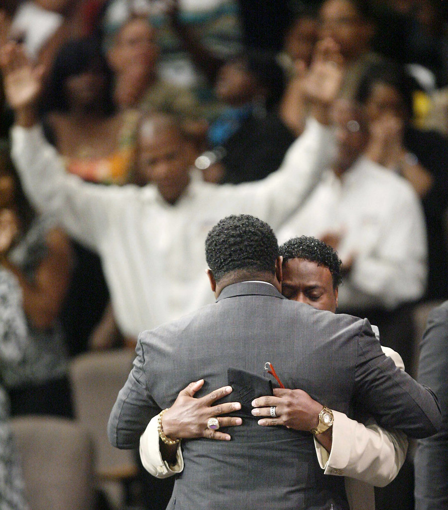 Bishop Eddie Long Embraces a Friend at New Birth Missionary Baptist Church