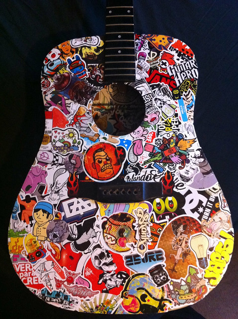 My sticker bombed guitar just thought i would show you my guitar d