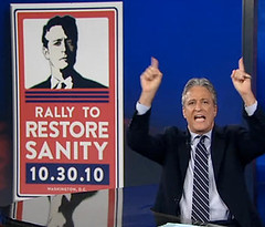 Jon Stewart and rally sign