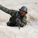 Afghan National Army Basic Warrior Trainee simulates throwing a hand grenade (13 Oct 10)