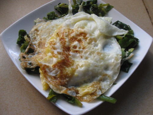 Fried eggs over spinach and leeks