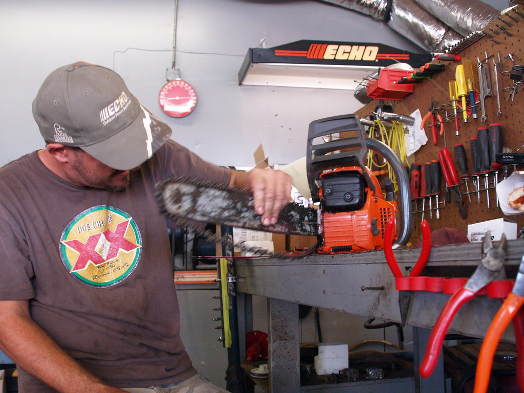 Pasadena Texas a Outdoor equipment repair guy named Todd is tring to fix a Hasqavera Chainsaw 2010 Chain Saw