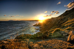 Setting (J.Shultz Photography) Tags: sunset sea cliff sun seascape grass clouds landscape rocks hill flare portmacquarie tackingpoint