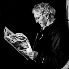 Reading (pandawizard) Tags: street blackandwhite bw london paper reading pentax candid ds ist pentaxistds