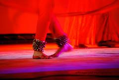 Nupur (artiagarwal) Tags: red woman motion blur art feet beautiful scarlet lights dance women dof artistic vibrant indian bangalore performance arts culture dancer depthoffield classical anklet nupur ghungroo kathak