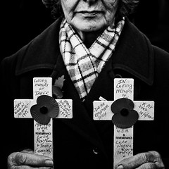 15/100: Norma Taker (petecarr) Tags: portrait people blackandwhite flags poppy poppies service troops wirral honour newbrighton remembrancesunday hoppe 100strangers
