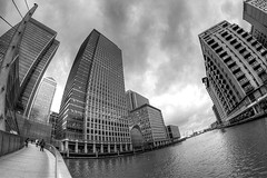290/365: CAVING IN (Austrian Alex) Tags: 365 canon50d blackandwhite samyang8mm docklands canarywharf banks architecture buildings water thames river o2 bridge fisheye hdr tcfunanimous thechallengefactory herowinner superherochallenges