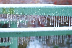 Ice Repeating ... (bigbrowneyez) Tags: wood brown snow cold green ice nature wet weather outside pretty patterns freezing deck transparent icicles linedup inarow glistening forming aquablue tinycrystals icerepetition