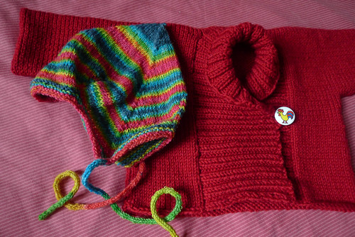 rooster sweater and stripey hat