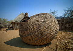 Mundimba tribe girl in giant basket - Angola (Eric Lafforgue) Tags: africa people tourism girl kid village child basket african culture tribal container human tribes blackpeople tradition tribe ethnic enfant cultura tribo angola ethnology panier tribu tourismo herero etnia 472 tnico etnias angolan ethnie hereros    mundimba suldeangola agolan      mudimba zembadhimba mudhimba southangola