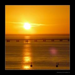 Lisbon Dawn ( WimKok) Tags: bridge sun portugal water sunrise river lumix dawn lisboa lisbon panasonic pointandshoot brug zon tagus rivier taag zonsopkomst vascodagamabridge ilustrarportugal lumixdmcfs30