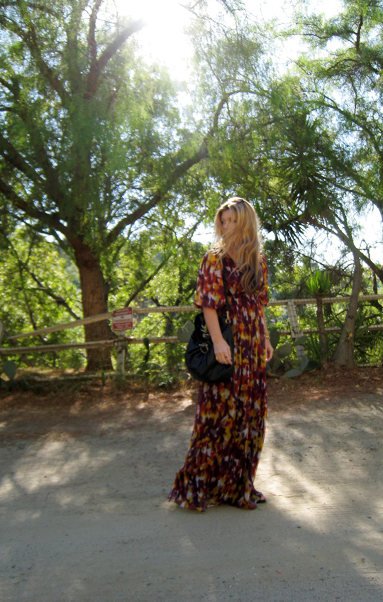 deserted road+trees+sun+long flowy dress+ferragamo bag+bright