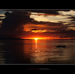 gone fishing ( seen on Explore ) (rev_adan) Tags: trip travel sunset sea sun fish beach water yellow clouds island prime boat fishing waves tour fishermen ripple philippines gb adan pinoy mindanao revo ef50mmf18 naawan revadan du9hgf