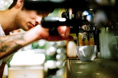 Pulling Espresso (Kym Ellis) Tags: guy film coffee tattoo kodak ae1 espresso barista extraction bendrury coffeearoma druzdruz