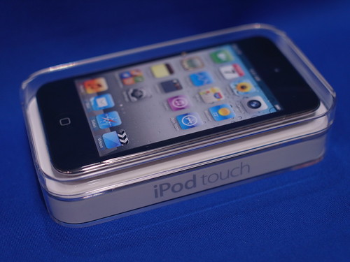 Apple New iPod Touch 4G. Small plastic box, compared with iPhone4